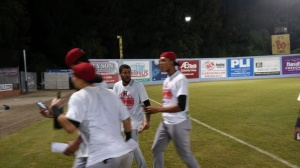 Pedro Payano (center) and Kelvin Vasquez (R) celebrating the SAL title (photo by Mark Parker